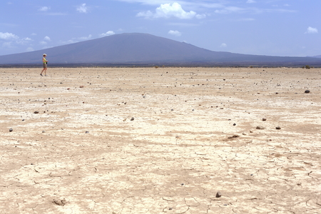 erased: Dry barren land of the Danakil desert-all tracks erased on the way from Afrera town to Dodon-basecamp to the Erta Ale volcano. View to the S.of Hayli Gubbi volcano at 521 ms. Afar region-Ethiopia. Stock Photo