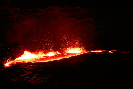 resplendence: World longest existing burning lava lake dating from 1906 in the Erta Ale-Smoking Mountain basaltic shield volcano at 613 ms.high-eliptic crater of 0.7 x 1.6 km. Danakil desert-Afar region-Ethiopia. Stock Photo