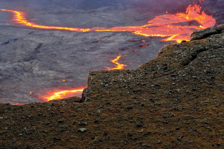 badland: World longest existing burning lava lake dating from 1906 in the Erta Ale-Smoking Mountain basaltic shield volcano at 613 ms.high-eliptic crater of 0.7 x 1.6 km. Danakil desert-Afar region-Ethiopia. Stock Photo