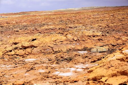 yellowish: Slope of Dallol mount rising over the surrounding flats of Lake Karum-Assale. Colored deposits of sylvite -KCL- carnallite -KMGCL3.6(H2O)- and kainite -KMG(SO4)CL.3H20. Danakil-Afar region-Ethiopia.