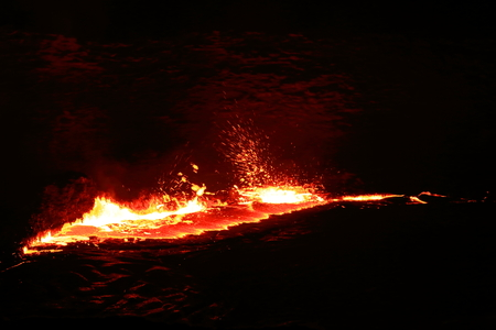 the existing: World longest existing burning lava lake dating from 1906 in the Erta Ale-Smoking Mountain basaltic shield volcano at 613 ms.high-elliptic crater of 0.7 x 1.6 km. Danakil desert-Afar region-Ethiopia. Stock Photo