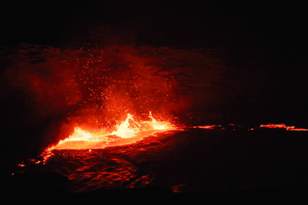 World longest existing burning lava lake dating from 1906 in the Erta Ale-Smoking Mountain basaltic shield volcano at 613 ms.high-elliptic crater of 0.7 x 1.6 km. Danakil desert-Afar region-Ethiopia. Stock Photo