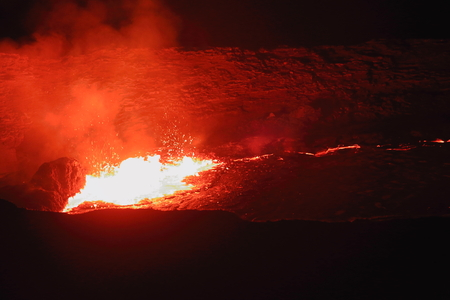 badland: World longest existing burning lava lake dating from 1906 in the Erta Ale-Smoking Mountain basaltic shield volcano at 613 ms.high-elliptic crater of 0.7 x 1.6 km. Danakil desert-Afar region-Ethiopia. Stock Photo