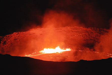 resplendence: World longest existing burning lava lake dating from 1906 in the Erta Ale-Smoking Mountain basaltic shield volcano at 613 ms.high-elliptic crater of 0.7 x 1.6 km. Danakil desert-Afar region-Ethiopia. Stock Photo