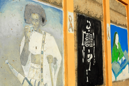 pedagogical: BERAHILE, ETHIOPIA-MARCH 29: Pedagogical graffiti on the school walls show some local cultural facts to the students on March 29, 2013 in Berahile town on the limits of the Danakil desert. Administrative zone 2-Afar region-Ethiopia. Stock Photo