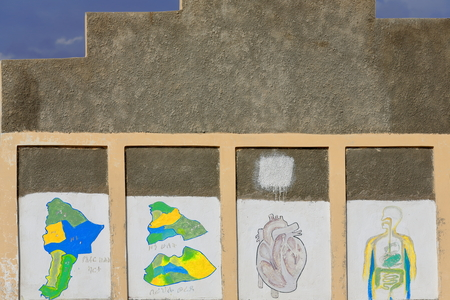 graffito: The school walls serve as outer blackboard displaying lessons for the students queuing at the schoolyard to enter their classrooms. Berahile-market for the salt from the Danakil. Afar region-Ethiopia. Editorial