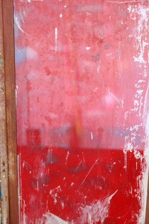 pedagogical: Pink and red painted closed wooden door on the wall of the local school at Berahile town on the limits of the Danakil desert. Administrative zone 2-Afar region-Ethiopia. Stock Photo
