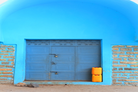 padlocked: Blue domed marquee and metallic closed door of commercial building on a street in central Mekele-Mekelle town and special zone at 2084 ms.high in Debubawi-Shouthern zone. Tigray region-Ethiopia. Stock Photo