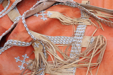 sewn: Ethnical traditional belts made of cowrie shells sewn on fringed leather straps set on orange color skins-Adi Haki open market of Mekele-Mekelle town in Debubawi-Southern zone. Tigray region-Ethiopia