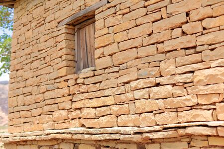 orison: Dry stone wall-wooden window-building on the outer wall of the compound of the Tewahedo-Ethiopian Orthodox Christian Wukro Chirkos rock-hewn church. Wukro town-Misraqawi zone-Tigray region-Ethiopia.