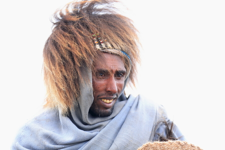 DEBRE BIRHAN, ETHIOPIA-MARCH 30: Amharic man wears baboon gelada hair hat as example of the local use for headdresses on March 30, 2013 in Meneliks Window mountain gorge near Debre Sina-Amhara region