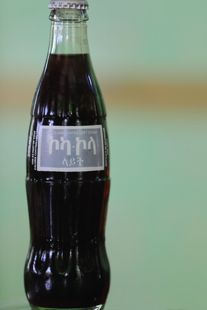 DEBRE BIRHAN, ETHIOPIA-MARCH 30: Ethiopia produces its own version of international drinks such as this bottle of the most world renowned refreshment on March 30, 2013. Debre Birhan town-Amhara region