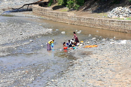 DEBRE BIRHAN, ETHIOPIA-MARCH 30: Locals use the waters of Baresa river flowing through Debre Birhan town to wash their clothes along with their bodies on March 30, 2013. N.Shewa zone-Amhara region.
