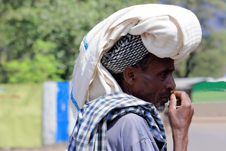 DEBRE BIRHAN, ETHIOPIA-MARCH 30: Amharic man wears enormous head scarf as example of the local use for headdresses on March 30, 2013 in Debre Birhan-Semien North Shewa zone-Amhara region. Editorial