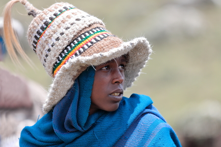 DEBRE BIRHAN, ETHIOPIA-MARCH 30: Amharic man wears several horse hair hats as example of the local use for headdresses on March 30, 2013. Meneliks Window mountain gorge near Debre Sina-Amhara region