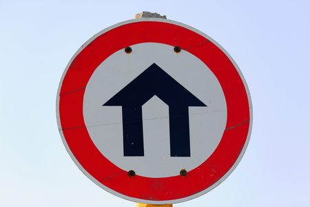 housebuilding: Road sign showing what seems to be a house-building on a white circle surrounded by a red rim indicating prohibition. Road from Kombolcha to Addis Ababa-Debub Wollo zone-Amhara region-Ethiopia.