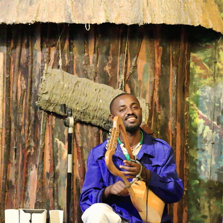 ADDIS ABABA, ETHIOPIA-MARCH 31: Local musician plays a 6 string krar or lyre while performing for the tourists in the Weyin Ethiopia Cultural Hall on March 31, 2013. Addis Ababa.