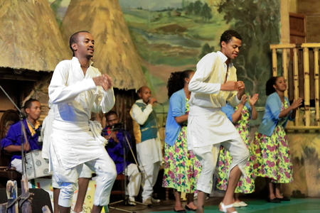 ADDIS ABABA, ETHIOPIA-MARCH 31: Local dancers and musicians perform traditional music and dance in a dinner show for the tourists in the Weyin Ethiopia Cultural Hall on March 31, 2013. Addis Ababa.