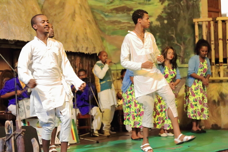 amplified: ADDIS ABABA, ETHIOPIA-MARCH 31: Local dancers and musicians perform traditional music and dance in a dinner show for the tourists in the Weyin Ethiopia Cultural Hall on March 31, 2013. Addis Ababa.