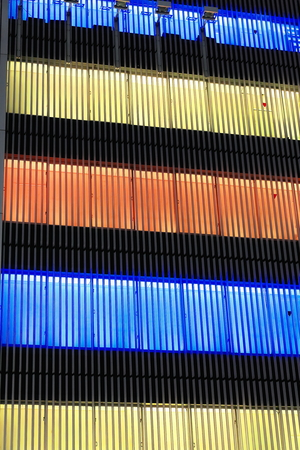 Blue-yellow-orange lights on at night of postmodern architecture building in Ginza ward at the Sukiyabashi crossroads on Harumi-dori illuminating the night of downtown tokyo. Honshu island-Japan.