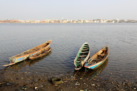 tinkered: View of South or Sindone district of the city-island from the mainland district of Sor across the river.s Grand Bras-Large Branch downstream from Pont Faidherbe bridge. Ndar or Saint-Louis-du-Senegal. Stock Photo