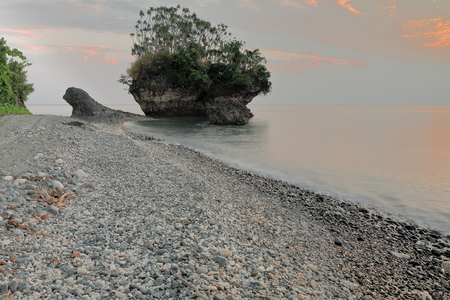 Tip of the headland N.of the village-the big and unusually shaped formation known as Captain Cook.s or Mushroom Rock gets surrounded by water at high tide. Panngi-Pentecost island-Penama prov.-Vanuatu