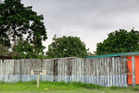 Parking area marked on a wood palisade limited lawn beside the chief marketplace in town at the West end of the main street-Higginson Boulevard. Luganville-Espiritu Santo island-Sanma Province-Vanuatu Foto de archivo