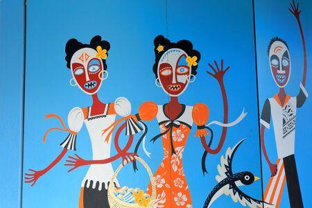Luganville, Espiritu Santo island, Vanuatu-October 16, 2014: The walls of many buildings along Higginson Boulevard-main street of town show local ethnic graffiti depicting local traditional motifs. Editorial