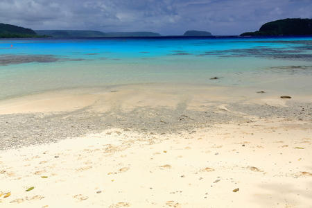 a bathing place: On the white sands and blue-green waters of Champagne beach in Hog Harbour bay closed on the N.by Elephant island the Americans celebrated the end of W.W.II. Espiritu Santo island-Sanma prov.-Vanuatu.