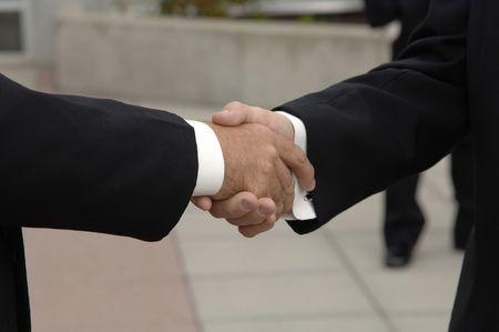 Friends shaking hands at wedding Imagens