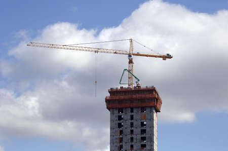 Construction crane on new highrise building