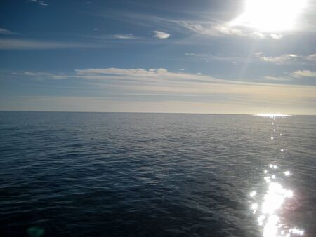 cruiseliner: View of the pacific ocean from a cruiseliner with the sun reflecting off of the dark blue waters