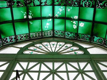 conservatory: Photo looking up at the stained and painted glass of the Volunteer Park Conservatory  Greenhouse in Seattle Washington