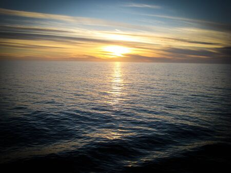 cruiseliner: A cruiseliner along the west coast of Mexico gives an elevated view of the sun setting in the pacific ocean