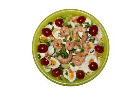 Salad with eggs tomatoes cheese and shrimps