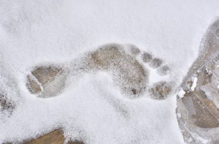 Footprint barefoot in cold snow