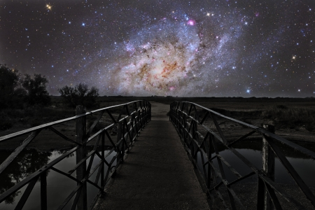 Bridge on a distant planet near the triangulum galaxy