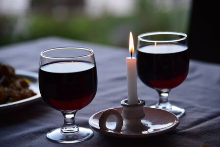 Glasses of wine and a candle