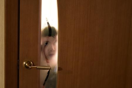 Child by the door