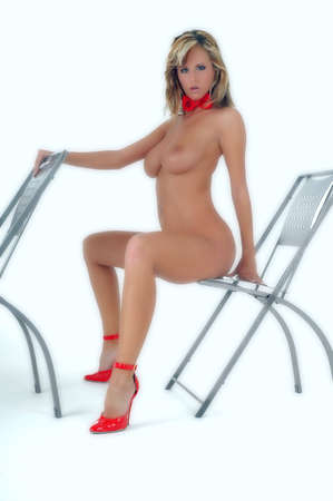 nude blond girl: young woman sitting on a chair