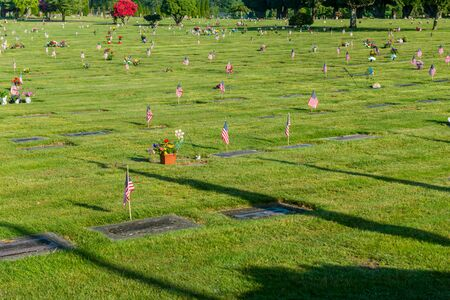 Gravesites decorated with American Flags. Stock Photo