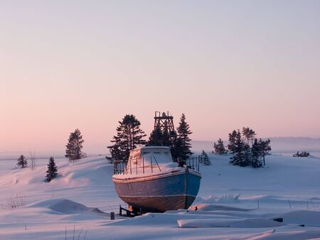 Little ship on coast of  White Sea, Russia Stock Photo