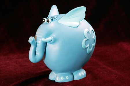 Toy blue elephant on red
