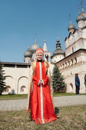 Girl in old Russian closes in monastery, Rostov-Velikiy, Russia