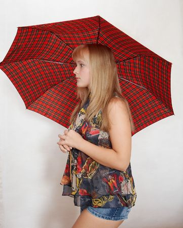 Young woman with umbrella on white photo