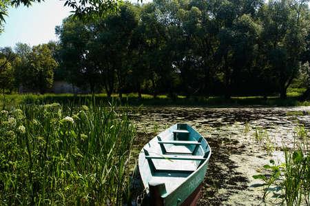 Boat on little river in Pereslavl-Zalesskiy, Russia