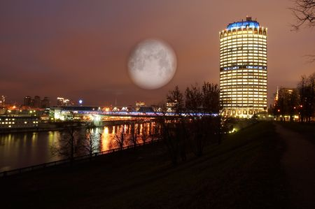 Night scenery of building Moscow City with Moon Stock Photo
