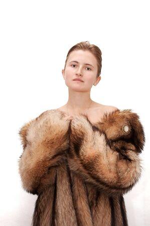 Woman in fur of racoon