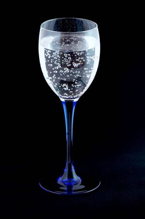 Glass with mineral water on black Stock Photo