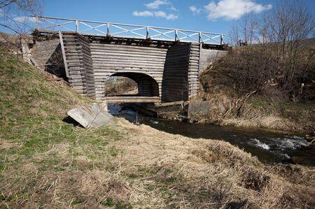 Old wooden bridge in Ferapontovo village, Russia